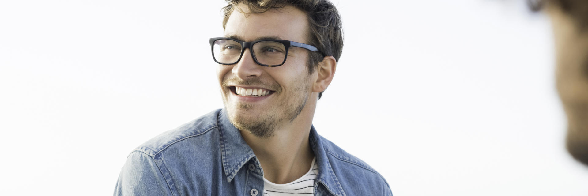 happy athletic man with glasses laughing