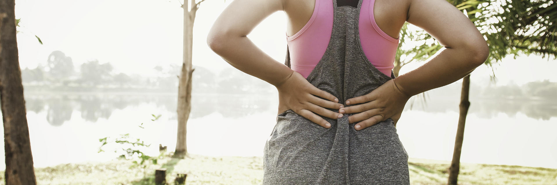 woman athlete's back pain hernia