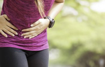 athletic woman stomach ache caused by hernia